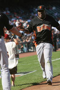 Former Giant Kevin Mitchell is Congratulated after a Home Run.