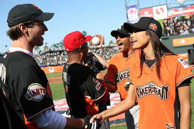 Mayor gavin Newsom shakes hands with Miss USA Rachael Smith after the game.
