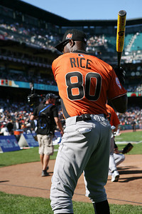 Jerry Rice takes a practice swing before going the the plate.