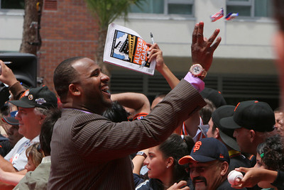 Unknown All Star throws candy into the crowd as he walks into AT&T park on the red carpet during the parade entrance for the players on the day of the All Star game.