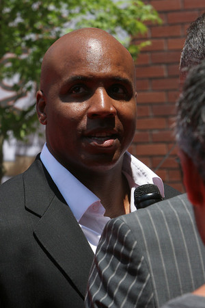 Barry Bonds conducts an interview as he walks into AT&T park on the red carpet during the parade entrance for the players on the day of the All Star game.