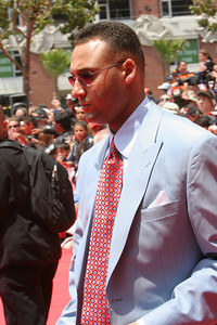 Derek Jeter of the New York Yankees signs autographs as he walks into AT&T park on the red carpet during the parade entrance for the players on the day of the All Star game.