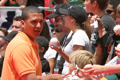 Unknown All Star signs autographs as he walks into AT&T park on the red carpet during the parade entrance for the players on the day of the All Star game.