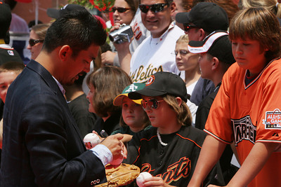 Unknown All Star from the Dogers signs autographs as he walks into AT&T park on the red carpet during the parade entrance for the players on the day of the All Star game.