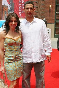 Jorge Posada of New York Yankees and his wife Laura walk into AT&T park on the red carpet during the parade entrance for the players on the day of the All Star game.