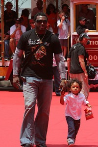 "David Ortiz ""Big Papi"" of the Boston Red Sox walks into AT&T park on the red carpet during the parade entrance for the players on the day of the All Star game."
