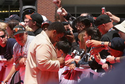 Unknown All Star signs autographs and walks into AT&T park on the red carpet during the parade entrance for the players on the day of the All Star game.