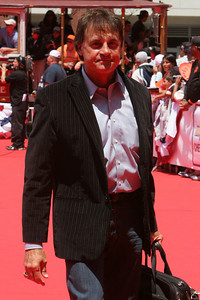 Tony Larussa walks into AT&T park on the red carpet during the parade entrance for the players on the day of the All Star game.