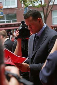 Alex Rodriguez of the New York Yankees signs autographs as he  walks into AT&T park on the red carpet during the parade entrance for the players on the day of the All Star game.