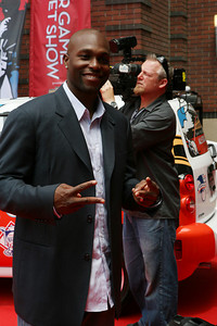 Tory Hunter of the Minnesota Twins Poses for the cameras as he walks into AT&T park on the red carpet during the parade entrance for the players on the day of the All Star game.