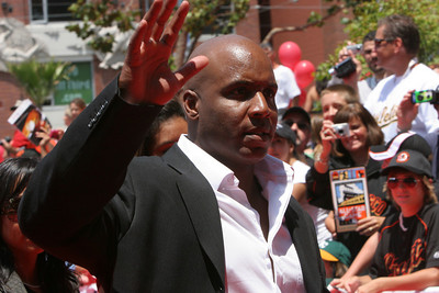 Barry Bonds cwaves to the crowd as he walks into AT&T park on the red carpet during the parade entrance for the players on the day of the All Star game.