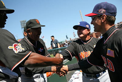 Manager Juan Marichal (center) congratulates his players on the win.