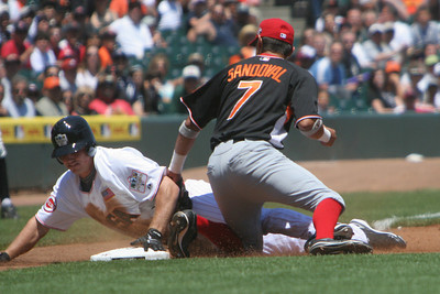#32 Bruce hits a triple and slides into third in the third inning.