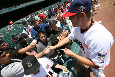Cleveland Indians player Chuck Lofgren  signs autographs before the Futures game.
