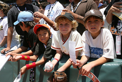 Kids wait for autographs before the celebrety softball game