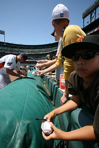 Fans wait for Cleveland Indians player Chuck Lofgren  as he signs autographs before the Futures game.