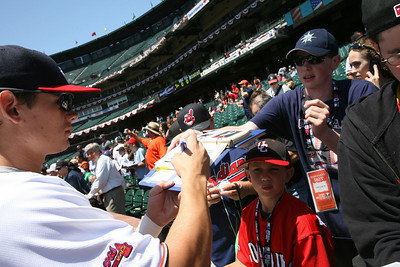 Atlanta Braves player Lillbridge  signs autographs before the Futures game.