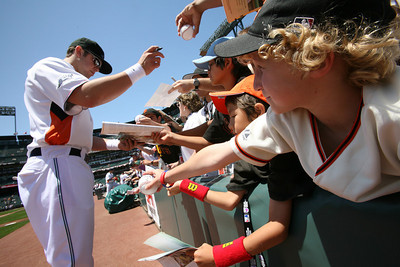 Giants Short Stop Brian Bocock  signs autographs before the Futures game.