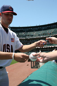 Cleveland Indians player Lofgren signs autographs before the Futures game.