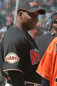 Barry Bonds smiles while waiting to take his turn during batting practice.