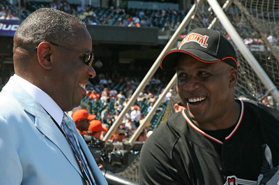 Dusty Baker and Bonds share a laugh during batting practice.