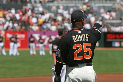 Barry Bonds walks out to take Batting Practice and points to where he is going to launch the balls.
