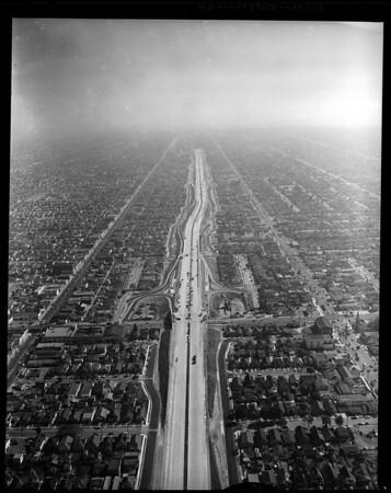 Air views of Harbor Freeway at 42nd Street South, 1957