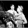 Miss Japan arrival at airport, 1958