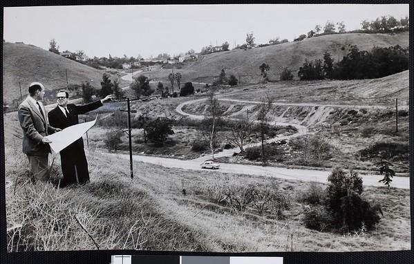 Mayor Norris Poulson (right) and Bob Hunter (left) surveying Chavez Ravine