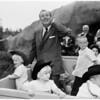 Walt Disney with grandchildren at Disneyland, 1960