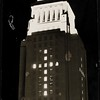 Night view of Los Angeles City Hall with traditional Yule cross formed by lights, ca. 1940