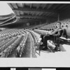 LA Dodgers Pitcher Don Drysdale trying out one of the first seats installed in the Dodgers ballpark