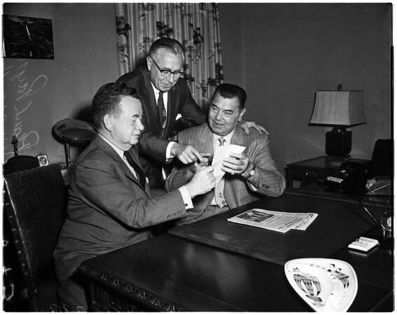 Jack Dempsey meeting with Frank Payne, 1957