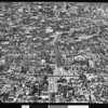 Birdseye view of several blocks in Los Angeles showing construction of Olympic Boulevard in the middle, 1940