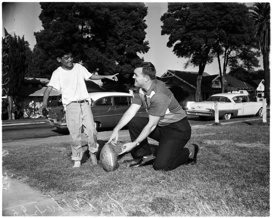 Football - Rams donate football to kid fan, 1957
