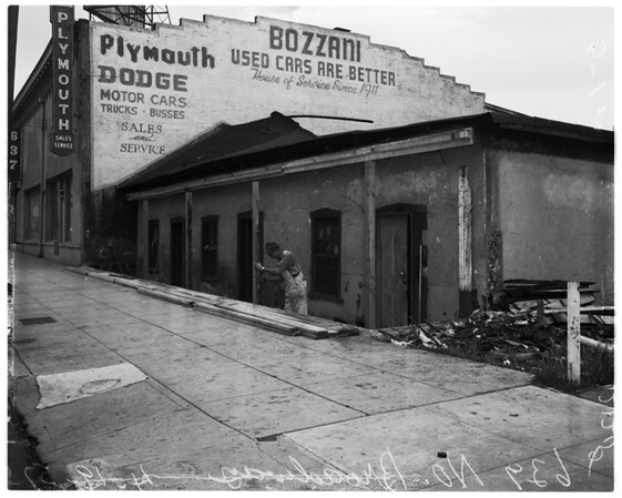 Wrecking old adobe building at 639 Broadway (North), 1957