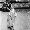 Boy tied to railroad tracks by two older boys, 1958