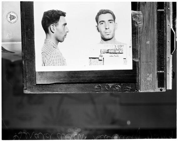 Forgery suspect (mistaken identity), 1959