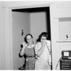 Murder suspect trapped in apartment house at 1114 North Poinsettia Drive in West Hollywood, 1959