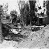Crane overturned trying to pull stuck tractor at Guardia and Huntington Drive North, 1958