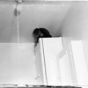 Monkey loose in home in bathroom at 6608 1/2 El Selinda in Bell Gardens, 1958