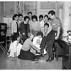 Roosevelt High School scoreboard (girls raise money for football scoreboard by shining shoes), 1958