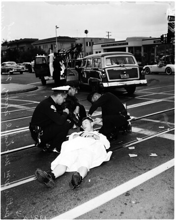 Priest injured in traffic accident at Wilton Place and Pico Boulevard, 1958