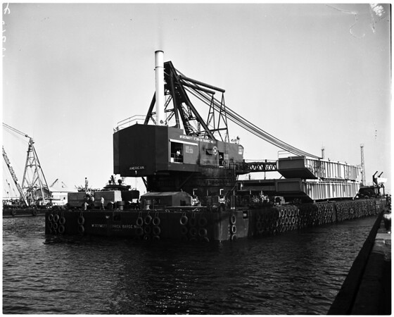 Barge entering Long Beach Harbor to pick up eighty-five feet, 1958