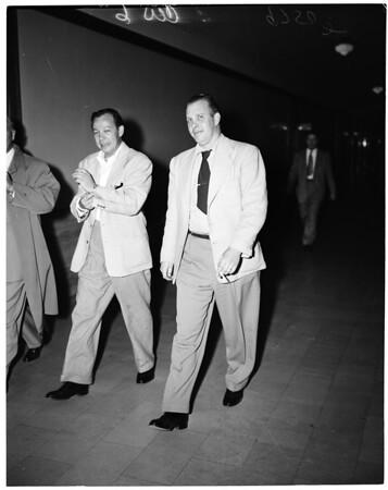 Murder suspect arrested, 1952