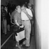Pleads guilty to grand theft of guns, 1961