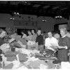 Needlework Guild of America gather and distribute garments for needy, 1957