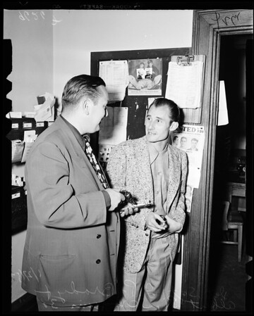 Holdup suspect at City Hall Robbery Division, 1952