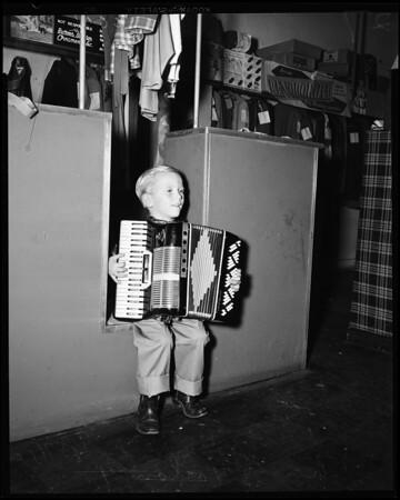 Boy plays accordion, 1952