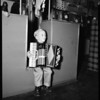 Boy plays accordion, 1952
